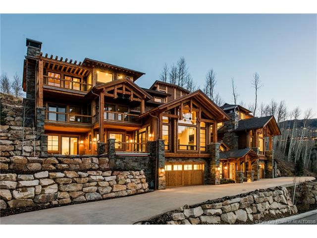 Nakoma is an exclusive ski-in/ski-out community of 17 individual mountain homes designed by Jack Thomas, AIA.  Luxurious appointments include heated stone entries, driveways and decks, distinctive hardwood floors and vaulted ceilings create a cozy, sophisticated ambiance.  Stone gas fireplaces lend warmth and character, while zoned radiant heat insures constant comfort.  Quality kitchen appointments include slab granite countertops and appliances by top manufactures such as Sub-Zero, Wolf and Asko.  Expansive decks and covered lower level patios invite you to indulge in soothing relaxation while enjoying the mountain scenery.  The setting is completed by stands of mature evergreens, groves of aspen and excellent winter sun.  Excellent ski access.
