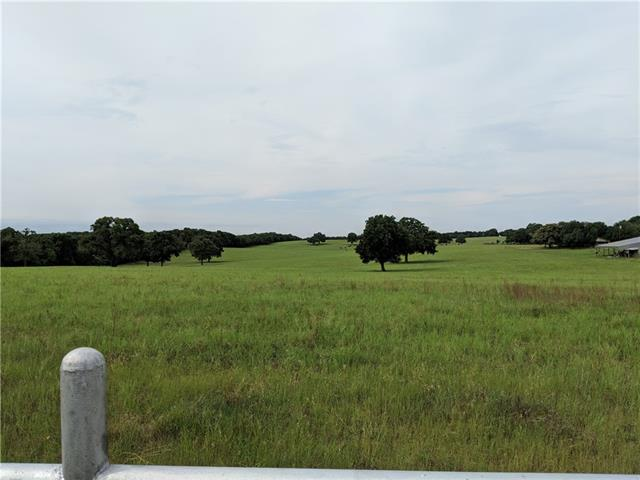 86 acres improved pasture/scattered native trees. Immaculate perimeter/cross fencing. 1 stock pond, 4,764 sqft quality barns, pens, cattle chutes. Paved/gravel road frontage. Paved private drive-2,075 sqft 3/2 custom home- 290 sqft mother-in-law suite, 1,500 sqft shop with built-ins/large cedar storage closet. 1,232 sqft 2/2/1 lodge/office/guest house. Significant remodeling/improvements including custom built-ins, crown molding, and wood accent walls and wood beamed vaulted ceiling. Views are incredible.