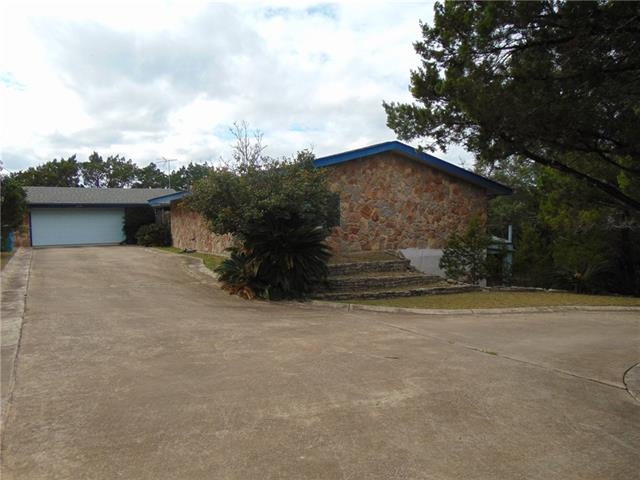 Make this your Hill Country Dream Home or Weekend Lake Retreat.  2572 sf plus extra 940 sf basement room (40 x 18) = 3512 sf.    Over 3rd ACRE.  Circle driveway.   Make this your DREAM HOME with some TLC.  Home is in good condition and livable but could use updating.  4 large bedrooms, 3 full baths, huge family room, grand stone fireplace, dining, kitchen, 2 car garage and 50 ft deck and patio.  Serene views of the hill country and lot of privacy. sold AS IS.