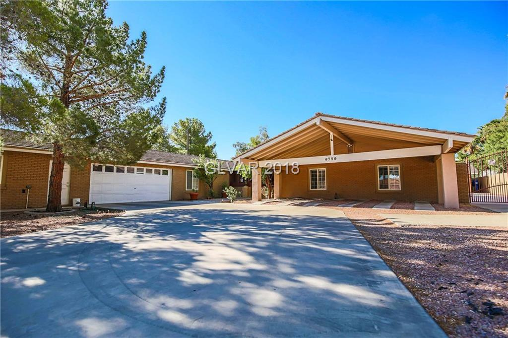 Own a Piece of History! Andre Agassi's childhood home!  Complete remodel w/the Bells & Whistles! 4 car garage! Pool! Tennis Court! Work Shop! RV Parking! Built in BBQ! Covered Patio! Upgraded: Ext brickwork, 2 frplc, granite counter tops/island, custom cabinets, tile/crpt flrs, plantation shutters dual pane windows, wet bar, double entry dr, bath: dual sink x2 @ vanity mirrors, Jacuzzi tub x2 & more! Master closet was 5th bdrm! Steel Appliances