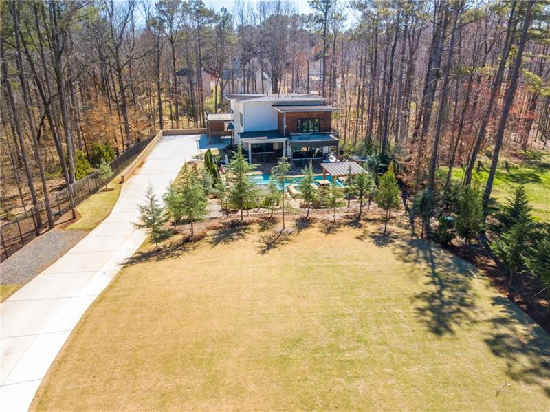 Stunning Gated Home on 1.3 Acres. Hardwoods or Marble Tile thruout. Chef's dream Kitchen offers Huge Subzero refrigerator & freezer,Wolf stovetop & ovens,Walk in pantry & Marble C'tops. 6 Bdrms including 2 Huge Bdrm terraces & 2 Bdrm Porches. All Walk in Closets. Finished Bsmt-Media Rm w/Premium entertainment & Surround Syst Pkg. Gym & Office. Huge outdoor living/entertaining space offers Stone Patio w/Outdoor Frplc,Cabana,Pool Bar,Full Outdoor Kit,bathrm,heated pool&jacuzzi. Lighted jets&sprinklers in pool. All property is Fenced In.*OWNER FINANCING IS AVAILABLE!*
