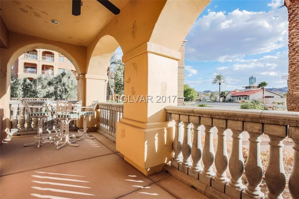 Spectacular Condo with Lake and and Mountain Views Located in a guard gated community. Multitude of upgrades including all appliance, wood, and travertine flooring, gourmet stainless steel kitchen, wet bar with wine refrigerator, and fireplace in family room. Large courtyard entry plus balcony off of living room and covered assigned parking.