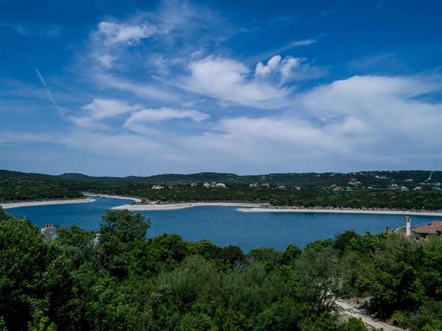 Incredible opportunity to own a deep water lot on Lake Travis with unobstructed view and a huge double boat dock.  Tram already in place to access dock. Dock can accommodate two large boats and could be modified to accomodate jet skis.  Plenty of room to party down here too. Storage rooms to keep all the toys.  Lot is already fenced and gated - very elegant setting.  Bring your own builder and design your dream lake home.  In the meantime, enjoy the lake with your own private dock.  You will fall in love!
