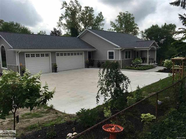 Wow, Feels Like New Construction, This Home Was Extensively Renovated In 2014, Including New Trusses, Drywall, Spray Foam, Roof, Anderson 400 Series Windows, Siding, Stone, 2 Furnaces, AC, Plumbing, Kitchen, Baths, Drywall, On Demand Tank less Water Heater, Exposed Aggregate Sidewalk & Patio, Porcelain Tile, 14KW Whole House Generator, Security System W/Cameras & DVR, Just To Name A Few?. You Will Fall In Love With The Open Concept Design Custom Kitchen With Spacious Granite Topped Island For Prep & Seating, 3 Door walls Over Looking The Black River, French Doors Leading To Your Master Suite With Full Bath & Walk in Closest With Custom Built Ins. Walkout Basement Offers Additional Full Kitchen, Full Bath, Possible 4th Bedroom And Sitting Area. Fenced Yard And Gradual Sandy Beach To Canoe, Snowmobile, Kayak, Jetski, Pontoon And More, Amazing Garage Space Consist Of 24x40 3 Car Attached Heated, 24x32 2 Car Garage, 24x50 Pole Barn With16ft Ceiling & 14x14 Door, 16x5 16ft Lean To.