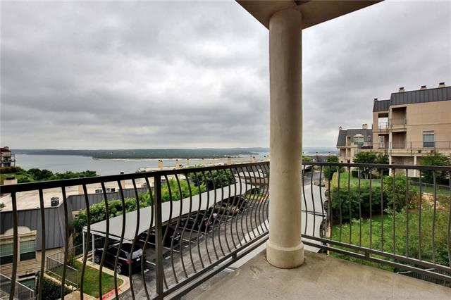 Enjoy the sunset from the balcony of this well-maintained condo overlooking Lake Travis. Gated-community with 2 pools, 2 hot tubs, fitness center, and dock access. Bright and sunny 2 bed unit with an open floorplan and spacious bedrooms. 9 ft ceilings and lovely wood floors that flow throughout the main level. Austin eats such as Lucy's fried Chicken and Hudson's on the Bend plus shopping, nearby. Low-maintenance living with exceptional views! New HVAC and water heater. 1-reserved carport included