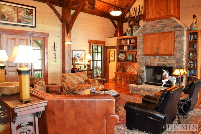 Incredible Post and Beam Masterpiece with 4 private master suites on 2 acres at 4000' elevation w amazing long range views of North & South Carolina Mountains. 4 bedrooms, 4.5 bathrooms. Cypress & Cedar siding, metal roofing, Laurel accents. 2 stone fireplaces--great room & on rear deck. Lots of natural light. Amazing woodwork in Great Room & every suite. Huge rear deck with lots of outdoor living space, built-ins and wood-burning fireplace. Very private, very well constructed. Wonderful kitchen