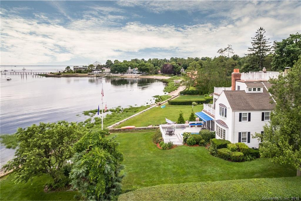 Known as Black Rock's Power House due to its distinguished residents, this handsome 1930s waterfront estate has seen just 4 owners in its lifetime. Enjoy views for days across Black Rock Harbor and LI Sound, where parades of sailboats pass by your windows, sunrises delight year-round & spectacular moonrises cast a path of light across the harbor. Feel the breeze & breathe in the cool salt air on 4 levels of decks including a rooftop observation deck w/ spiral staircase. The sandy beach beckons just steps from your door w/ space for a dock. Explore the friendly, vibrant community, Black Rock's beautiful waterfront & nearby restaurants & enjoy front row seats for Black Rock signature community events including Black Rock Day & PorchFest. FEMA compliant
