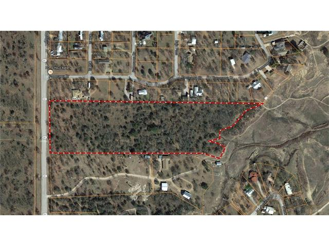 Lake Buchanan.  12.135 acres with approximately 570 feet of waterfront.  Level land, heavily wooded.  After clearing there would be outstanding views of Lake Buchanan.  Excellent building sites.  Approximately 398 feet of State Hwy 261 frontage.  No restrictions.