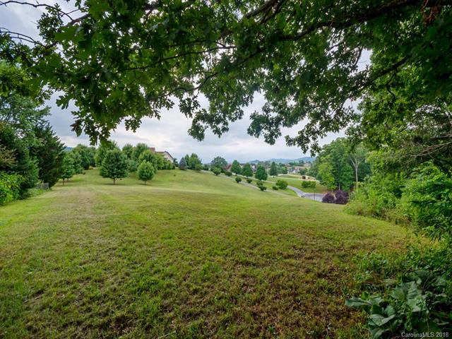 A BEAUTIFUL COUNTRY SETTING to build your dream home! Wonderful build site on a hillside meadow, with gently rolling hills, and mountain views. Cul-de-sac street. Underground electric & phone utilities are in place. City water. Septic permit approved. So convenient -- @8 miles to the Blue Ridge Parkway, @14.6 miles from downtown Asheville, @11 miles to the Asheville Regional Airport.