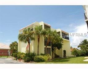 OUTSTANDING SAILBOAT PROPERTY. PRIME LOCATION,  TURNKEY FURNISHED!!!!!!  Beautiful 3 story building each with it's own entrance right at Harbor and Isles Yacht Club.  Great Seasonal Income with a chance to have a beautiful home and rental income at the same time.  Quality furnishings, 3 complete kitchens with granite, multiple air conditioners, many screened lanais from big to small.  Baths have decorator tiles, Laundry Facilities on each floor.