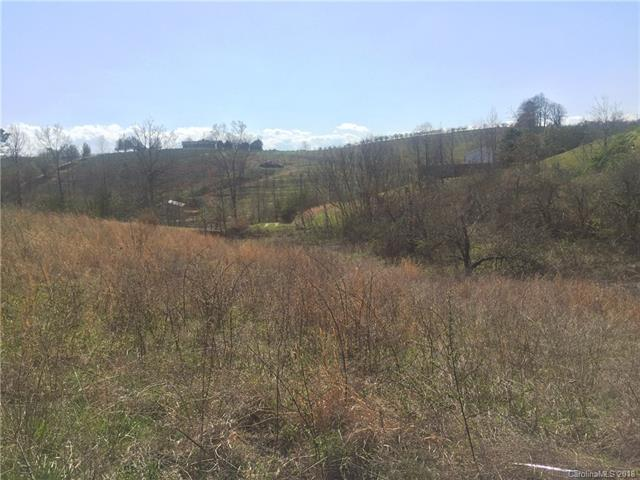 Great 0.7 acre lot! Perfect for a double-wide or modular home. In a well established subdivision with fantastic long range and sunset views, and surrounded by beautiful apple country!