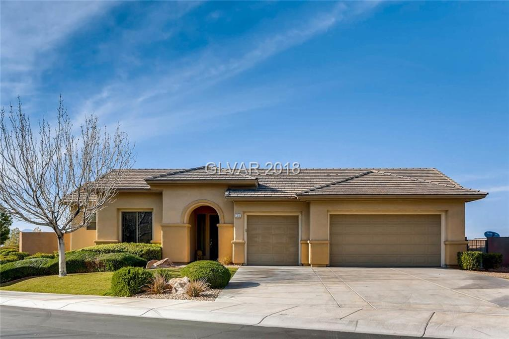 Spectacular Las Vegas Strip & Mountain Views. Elevated 1/2 Acre Lot. Entertaining Backyard with Waterfall Pool and Large Spa. Stone Outdoor Kitchen, BBQ with Burner, Kegerator, Fridge. Stone Accent Front & Large Atrium with Fountain. Granite Kitchen-Full Slab Backsplash, Butlers Pantry with Wine Refrigerator. Travertine in Master Bath with Steam Shower and 2 Walk In Closets. Den can be 4th Bedroom. Imported Tile. Full Landscape.