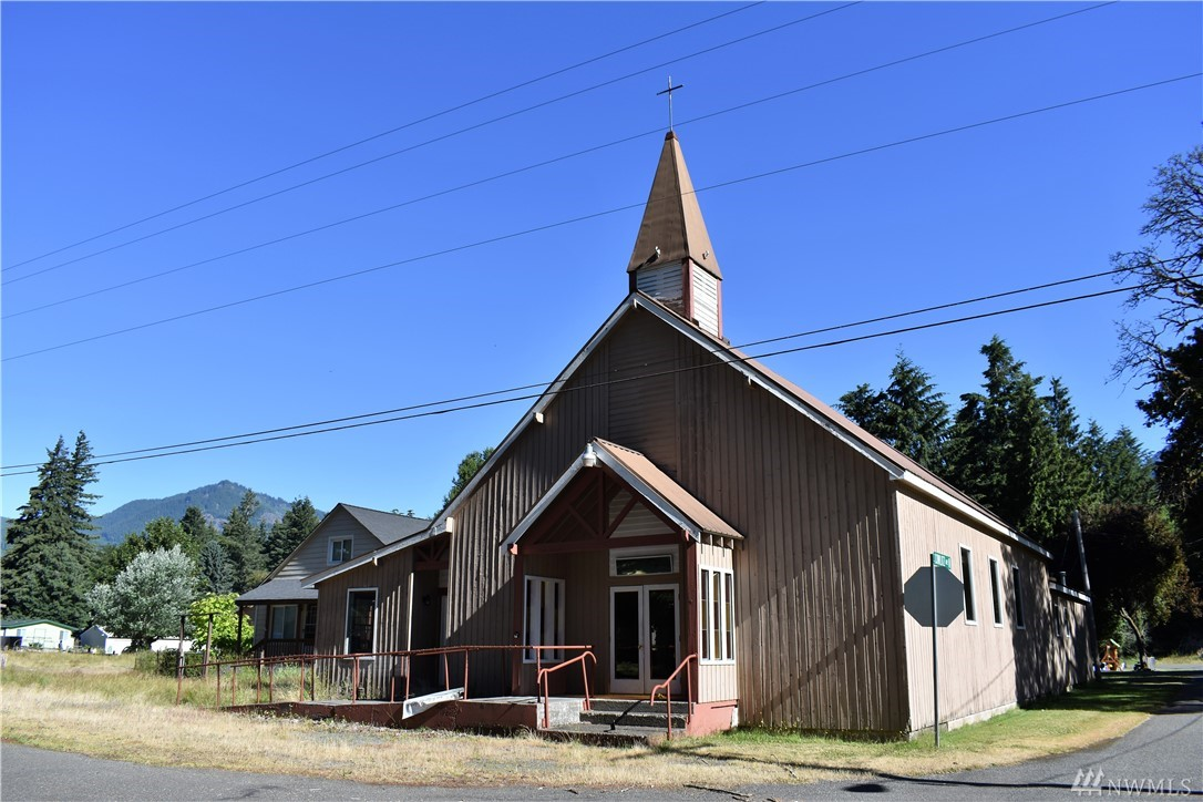 Investment property available in downtown Packwood. Surrounded by year-round recreational opportunities. Church (4036 sq ft) and parsonage (2000 sq ft plus basement) zoned small town mixed use. Additional outbuilding.  Three parcels provide ample opportunity for further customization. Potential for rental income. Church building includes 3 bathrooms, kitchen space, high ceilings, plenty of additional rooms, and ramp access. Home includes 3 bedrooms, 1 bath, upstairs bonus room, and basement.