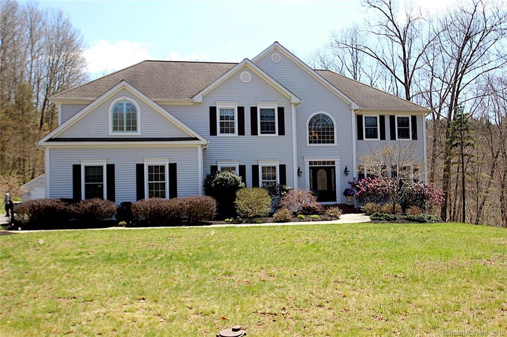 Beautiful custom built 5 bedroom colonial in newer Lake Area cul-de-sac community in Newtown. Large 4+ acre parcel with gorgeous views. Lovely gardens and flowering trees among a tumbled stone patio and integrated fire-pit. Beautifully cut blue stone walkways. 2 story open foyer with stairs and impressive handrail that winds to the second floor. Spacious gourmet eat in kitchen. Maple cabinets, granite counters and tile backsplash, serving island, all stainless appliances including Bosch dishwasher and double-wall ovens. 6 Burner gas cooktop with warming drawer, wine chiller and Whirlpool side by side refrigerator. Family room with floor to ceiling granite fireplace. Dining room easily sits 10 right off the kitchen. Living room and a large office/den are separated by the entry foyer where you'll find a powder room. 3-car attached garage steps into kitchen. Partly finished lower level with walkout. 5 bedrooms up including a huge master bedroom ensuite- walk in closets, trey ceilings and a full bath that promises to pamper. Second bedroom has private entrance to the hall bath and two other bedrooms share a jack and jill full bathroom. Recently updated bathrooms, updated kitchen, gorgeous family room fireplace and a sensational master bedroom. 20kw generator that powers the whole house. Enjoy a short walk to the Upper Paugussett State Forest for miles of trails and biking paths. Lake Lillinonah with boat launch is minutes away. Come take a look-this house promises to impress!