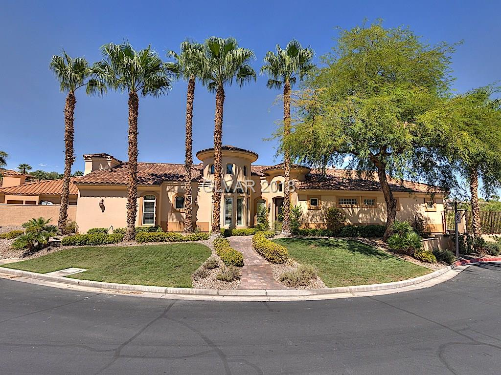 Welcome home to this former Lake Las Vegas model w/many upgrades including custom paint, stone floors. Intimate cobblestoned front walkway leads to gorgeous stone mosaic entry. Open great room/dining area with w/fireplace tie into kitchen w/granite counters, SS appliances, double oven, chef-style grill-top stove and fridge. Pool/spa enjoy spectacular golf course views and discreet side garage make this open Tuscan floorplan lovely and inviting!