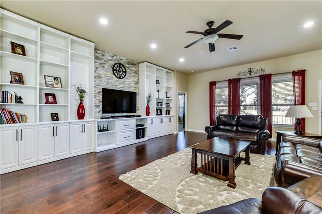 "Incredible floorplan! Large single story w/4 beds + study, 3 full baths AND 3 car garage! This is hard to find!  NO neighbors to the left! Located on a semi-culdesac w/ a natural greenbelt w/walking trail to one side of the home. Featuring hardwood floors & gorgeous, custom built-in entertainment center. Kitchen boasts beautiful 42"" cabinets, built-in pull out trash drawer, stainless venthood, glass tile in-lay backsplash, ample counter space w/ artisan finished granite and under-cabinet kitchen lighting!"