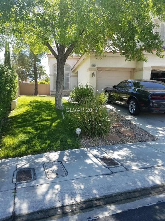 Beautiful 5 bedroom home, gated community, sparkling pebble tec pool with waterfall, covered patio and lovely landscape. Granite countertops, tile flooring, vaulted ceilings and bedroom downstairs. Close to shopping, parks and Summerlin Pkwy.