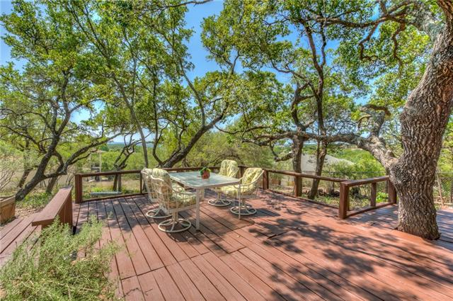 This beautiful home is quietly nestled on over 0.5-acre corner double lot in a peaceful neighborhood. Very private backyard w/large trees that slopes down providing amazing lake & hill country views. The gorgeous tiered decks are an entertainer's delight. Family rm w/wood-burning fireplace & great views of the backyard, remodeled kitchen & baths, laminate flooring in common areas, master retreat w/double vanity bath, & 2.5 car garage w/extra storage. Lower lot behind house could be subdivided or sold off.