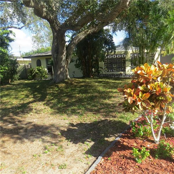 LIGHT AND BRIGHT HOME ON LARGE, PLUSH LOT LESS THAN A FEW MINUTE DRIVE TO BEACH!! HOME BOAST STUNNING COURTYARD LANAI SURROUNDED WITH TON'S OF GREENERY . A GREAT SCREENED IN AREA,  SO YOU CAN HAVE OPEN THE WINDOWS AND DOORS TO THE MAIN HOUSE AND LET THE FRESH AIR IN DURING Back on the Market 12/20/17. THESE MILD DAYS AHEAD. TON'S OF NATURAL LIGHT ENTER THE HOME FROM OVER-SIZED WINDOWS TO THE LIVING ROOM AND KITCHEN. HOME BOAST BRAND NEW A/C SYSTEM (AUGUST 2017), NEW FLOORING IN MASTER, EXTRA PARKING PAD OFF 1 CAR ATTACHED GARAGE, GREAT FOR GUEST, RV, BOATS. HUGE FENCED IN PRIVATE BACKYARD WITH EXTRA STORAGE SHED. WALK IN CLOSET AND OVERSIZED MASTER BATH MAKE THIS A COMFORTABLE HOME ON QUIET STREET. MINUTES FROM BEACH, SHOPPING, DINING, SCHOOLS. GREAT FOR THOSE THAT LOVE TO ENJOY THE OUTDOOR'S WITH ITS RARE OVER-SIZED OUTDOOR LIVING SPACE.