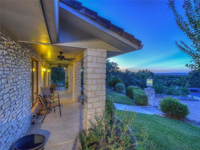 Charming classic home in a quiet cul-de-sac w/beautiful hill country & lake views. The oversized lot backs to Summit Rock golf course's wooded greenbelt complementing serene outdoor living. The open floor plan accommodates a great place to entertain or relax and includes two large living areas which flow into an ample dining area and spacious kitchen enhanced by granite countertops and stainless steel appliances. Floor to ceiling windows in both living areas provide abundant natural light.