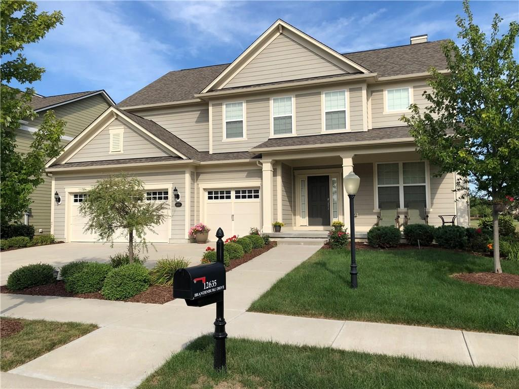 Gorgeous 4 bedroom 3.5 bath home located on a spectacular lot.  Gourmet kitchen with a huge island, granite, stainless steel appliances, walk-in pantry plus planning center with lots of cabinets.  Open floor plan, fireplace, hardwood floors on the main, soaring ceilings, wonderful master, custom tile shower, tile floors, garden tub and large walk-in closet. Mud room with bench and storage lockers.  Finished day light basement with full bath, lots of storage, 3 car garage, and a large deck to enjoy your evenings.  Home backs up to a large green space area. Full irrigation system.