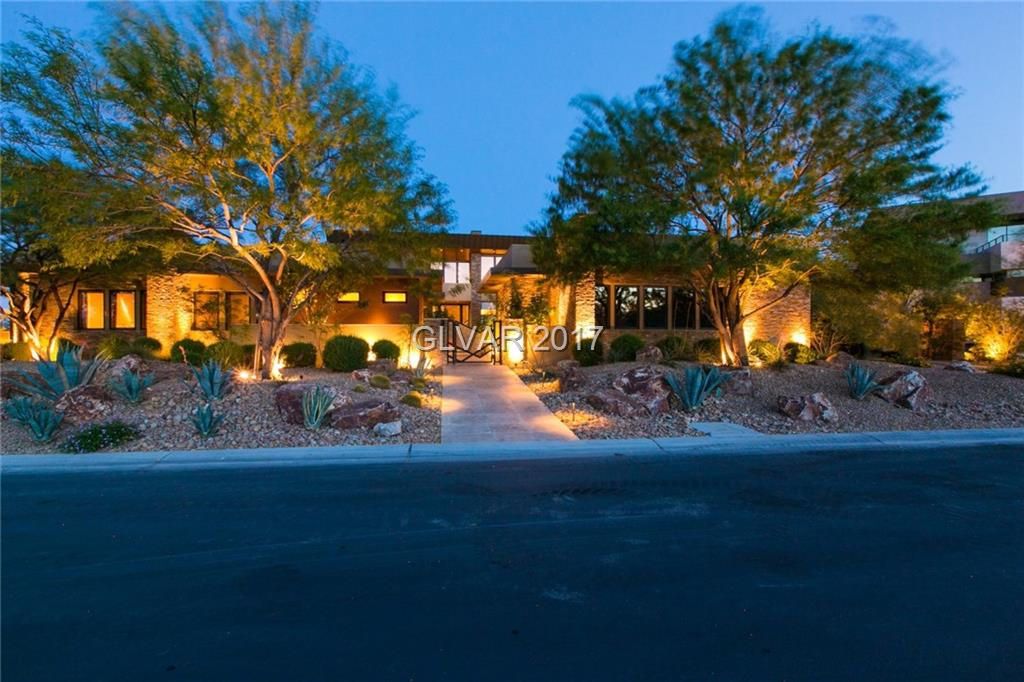 This astounding contemporary home captures picture perfect views of the Strip & offers an entirely open floor plan. Vaulted ceilings composed of dark wood sweep through the main level which features a chef's kitchen, expansive great rm, master bdrm, office & 2 bdrm suites. Lower level includes family rm, home theater, 2 bdrm suites, fitness rm, sauna & more. Lagoon pool is partly covered plus fire pits, waterfalls &yard.
