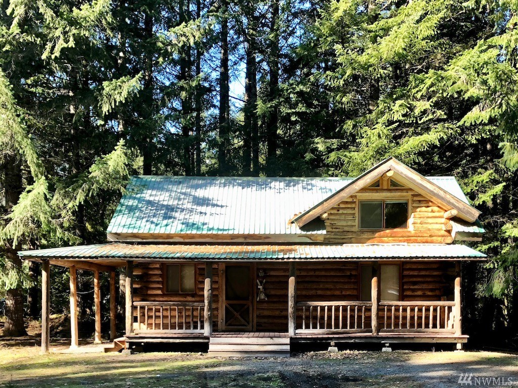 Adorable log cabin on a secluded lane in the Timberline community near Mount Rainier and White Pass Ski Resort. It features one bedroom on the main level, and a loft with beautiful windows and charming lines. Enjoy relaxing on the classic large covered front porch or roasting s'mores in the fire pit out back, adjacent to peaceful forested green space.  Community clubhouse, playground, pool and tennis courts. HOA  Make this Instagram-ready home your mountain escape or perfect vacation rental!
