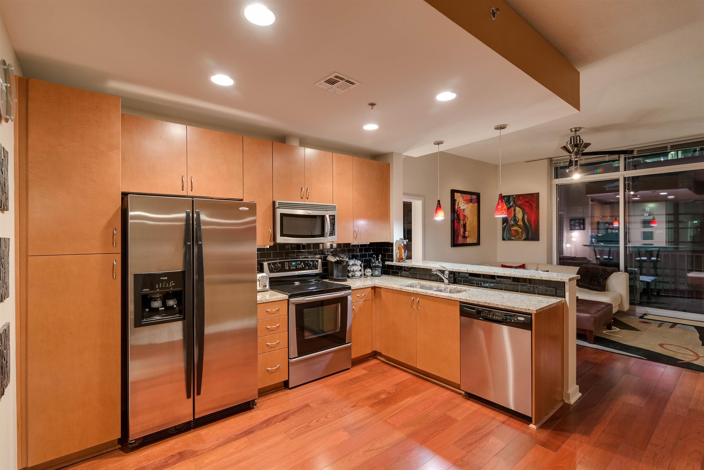 Hardwood floors, ceramic tile, Whrilpool washer, dryer, Whirlpool gold refrigerator, microwave & dishwasher. 24 hour concierge, controlled access entry, fitness center, pool, downtown views, close to everything.