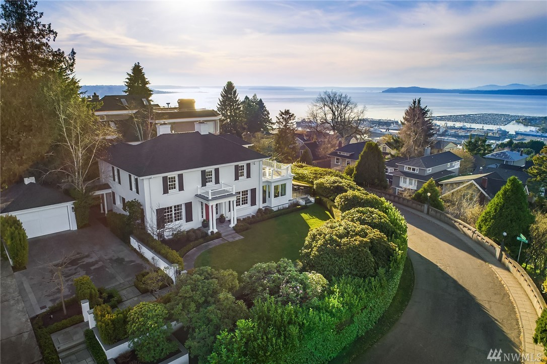 Stunning Colonial Revival home on Queen Anne Blvd with spectacular views of Puget Sound and Olympic Mtns. This stately home was designed in 1921 by Harlan Thomas. Completely renovated in 2015 by architect Anne Adams and Toth Construction to improve functionality of the home and create a harmonious space that is cohesive. Open floor plan provides modern living and whimsical touches that blend with traditional elements. A formal pathway to the entry portico welcomes you home.