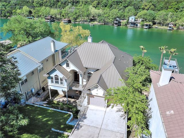 Gorgeous 2 story home on Lake Austin.Furniture negotiable. Never lived in.5 beds,4.5 baths.New carpet,refinished  wood floors added 2017.Boat/party dock with Jet ski lift.Granite and stone counters thru out.Appliances convey.The gracious Master & guest bedroom are on the main level. 3 large bedrooms, exercise room/office and a Gameroom/wet bar down.Open floor plan/high ceilings.Views of Lake and Hill Country from almost every room.Spectacular covered porches on both levels Exemplary Leander ISD. Heavenly!