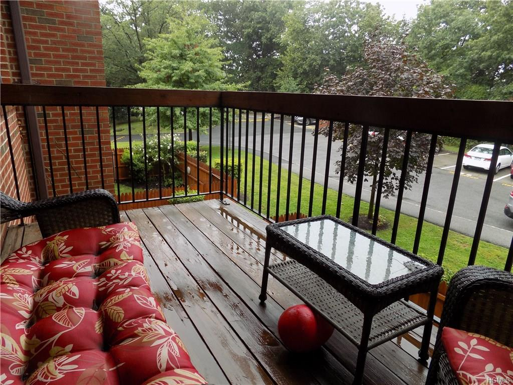 Sought after spacious 1 bed Condo rental with large private balcony off living room in 24-7 gated community.  Wood floors throughout except bedroom. Washer and dryer in unit.  Central air conditioning. Huge separate storage outside unit. Walk in closet, assigned parking.   Enjoy outdoor pool in park like setting.  Close to metro north railroad, Bus, shops and highways.