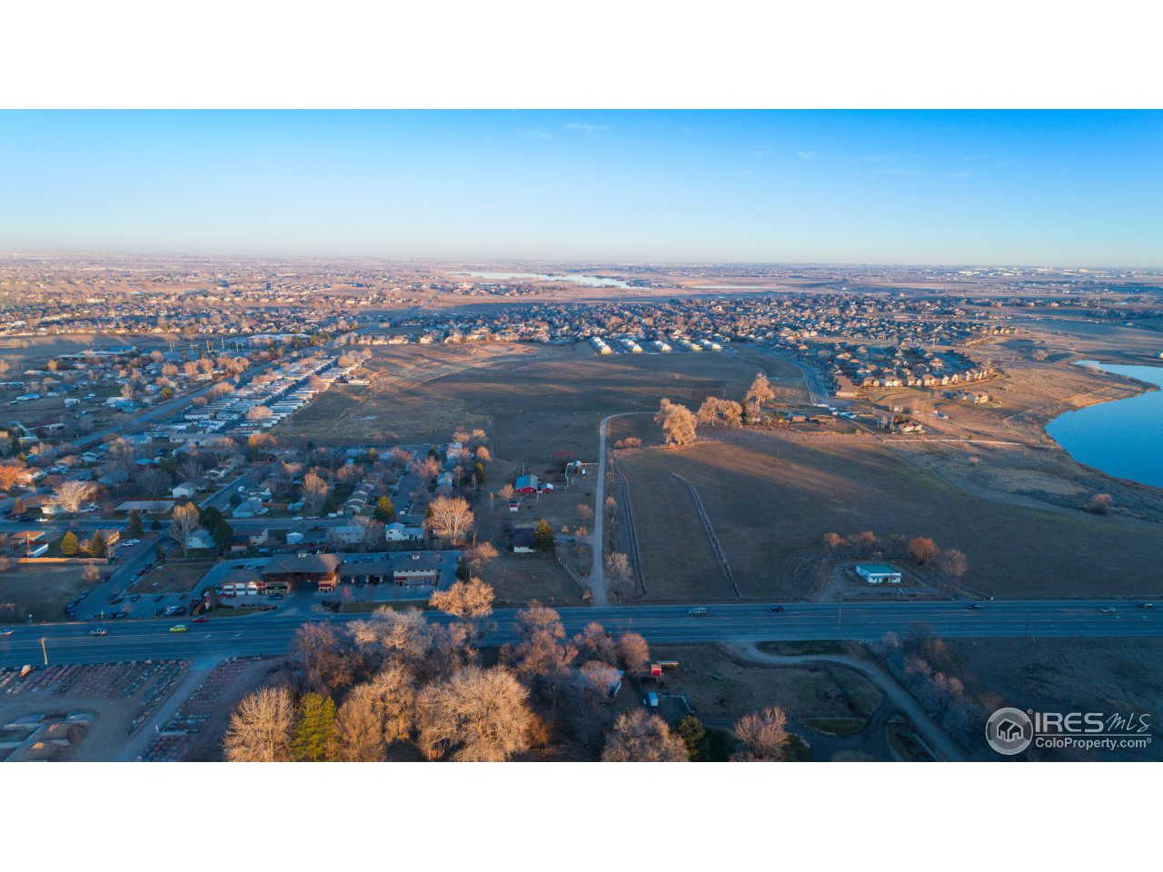 PRIME DEVELOPMENT OPPORTUNITY! !! This 33.5 acre parcel is located in south Fort Collins, and minutes to Loveland!  Developers, builders, and investors look at this tract zoned multi family-mixed use,up to 9 units/ac also allows for wide range/mixed housing choices and variety of commercial/retail uses.  Rental home on property with barns and garage.  Call agent for additional information.