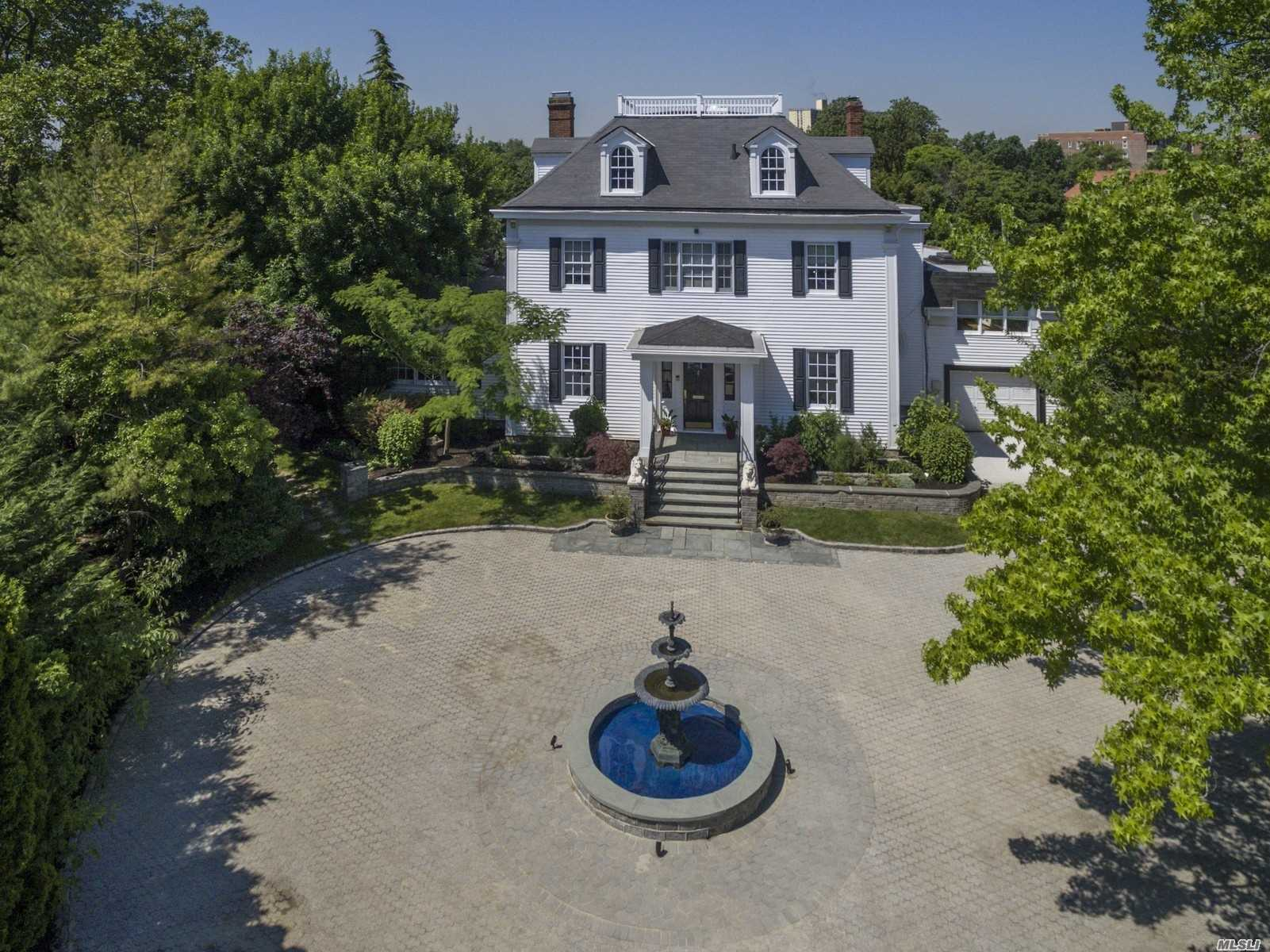Bayside Gables Stunner. 5Br,3.5 Ba Colonial Sits On Near 1/2 Acre. Pvt.Cul-De-Sac,Circular Drive,Fountain,Foyer,Grand Staircase,Banquet Dining Rm W/Fp, Formal Livingrm W/2 Woodburning Fp. Solarium W/Oak Coffered Ceilings, 2 Of 8 Skylights, Sun Drenched Great Rm Off Sub-Zero,Viking Kitchen, Pwdr Rm. 48Ft. Studio Off Kitchen, Mud Rm. Upstairs 2 Levels Of 5Bed 3Bath Inc. Mbr/Ste W/2 Fp's+ Dressing Rm.