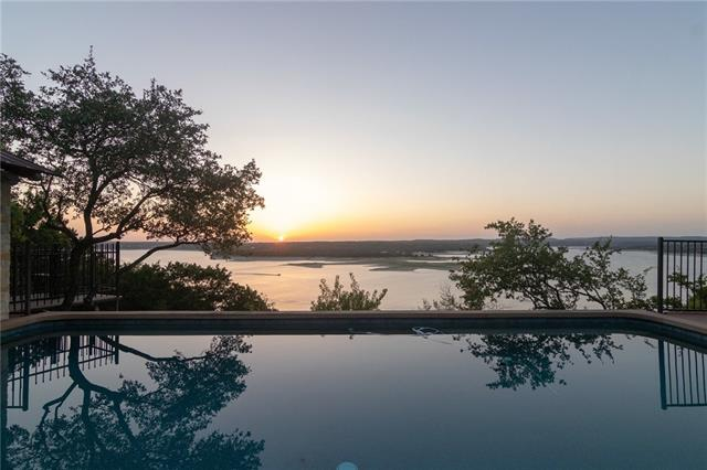 Incredible Lake Travis waterfront estate boasts 3.4 acres of fenced, gated and extensively landscaped lawn. Panoramic Lake Travis views and deep main body water frontage. Original home built in 1932-Owners commissioned their Architect to design a new luxury residence preserving a piece of the original home's history. Guesthouse originally built in the 1800's-completely renovated in 2013. State of the art tram, custom boat dock, sparkling pool, detached exercise studio and 5 car detached garage.