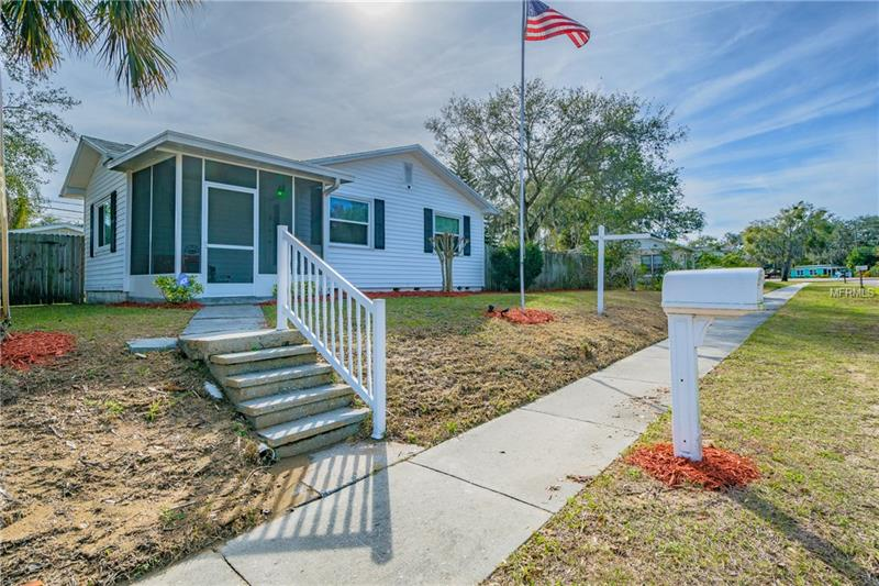 """Opportunity knocks, at this one of a kind, adorable cottage in downtown Safety Harbor! This 2 bedroom, 2 full bathroom home is located in the heart of Safety Harbor, walking distance to shopping, dining, breweries and much more! There's custom cabinets, detailed wood work, and stone surfaces throughout! You'll love the pull-out shelving in the kitchen & many other organizational phenomena & conveniences inside all the custom cabinetry. The 2nd bedroom has a Murphy bed that folds up into the wall with doors to close off the stored bed & it can also be used as an office with its built in desk! The 2nd bathroom has an incredible amount of storage & features a glass shower & granite countertops. Check out the photos. Oh! and there's a HUGE yard! That's right, we said HUGE yard, in downtown Safety Harbor! One large area is already fenced in with a big 24x11 ft deck and there's also a 2nd yard on the other side of the house that could make for a great playground area or dog run to keep outdoor fun separated. Although the original garage was converted to living space, there is plenty of parking (up to 5+cars) (or even an RV or large boat) as well as a detached building that was previously used as a golf cart garage. This 12x16 outdoor storage building is """"finished"""" & has a number of different uses: golf cart garage, storage, riding lawn mower, exercise room, office - it already has crown molding, two ceiling fans, built-in custom cabinets and shelving! Schedule your showing today! Live the way you want..."""