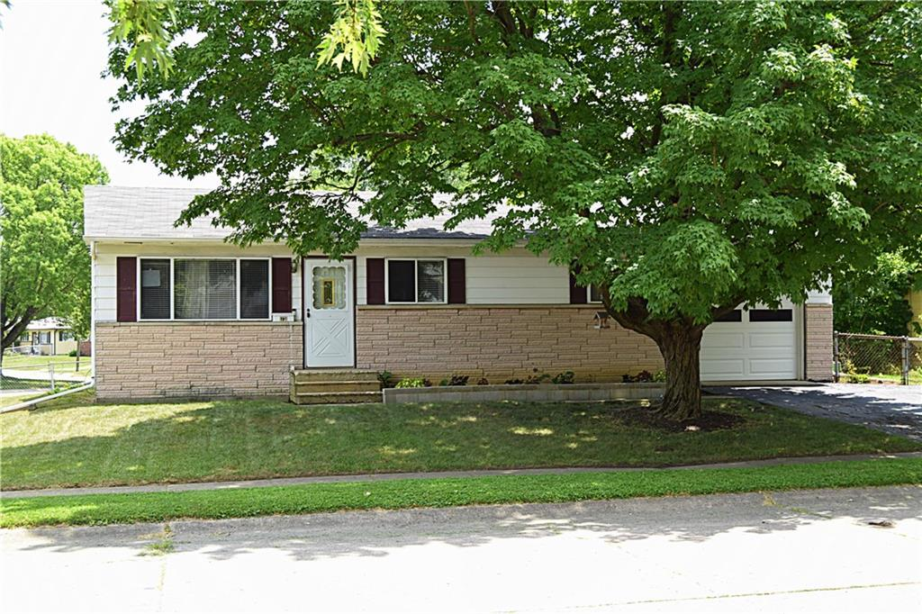 Fantastic opportunity for a first time home buyer, those looking to downsize, or an investor.  Minutes from Beech Grove, downtown Indianapolis, 465 loop and all things Southside Indy. Home sits on a spacious corner lot in an established neighborhood and has been lovingly maintained and updated.  Hardwood floors adorn most of this move-in ready home.  Kitchen has been totally remodeled with new appliances (including a gas stove), new vinyl flooring, new counters, cabinets, hardware and new sink.  Seller has added a half bathroom (new toilet and pedestal sink) accessible from both the kitchen and the master bedroom.  Partially fenced yard is well manicured & complete with shed, firepit, and raised garden beds.  Washer and dryer are included!