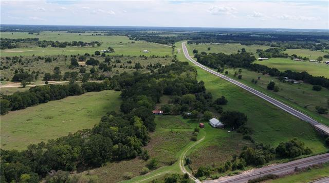 Great location! This 278.99 acre property is perfect for use recreationally as well as for livestock. 9 ponds, rolling terrain, several wet-weather creeks. Property is approx. 60% wooded. Fair to good fencing around the perimeter and is currently used for cattle and hunting. Older home that would be great for a cabin or to use while you build. Highway frontage on two sides and in a great location from Austin and B/CS. Less than 2.5 hours from Houston, San Antonio and D/FW.