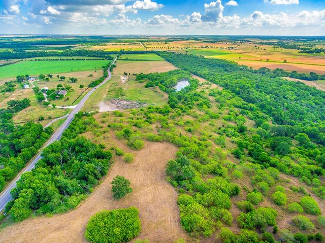 47.75 acres of beautiful countryside with no restrictions and AG exempt. Nice hill views and large trees. Has part mine site/fill site, all clean fill. No utilities.