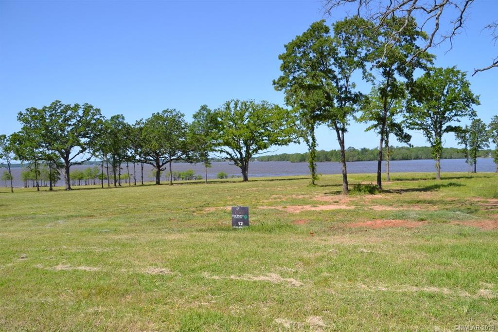 Stunning 1.137 Lakefront Lot In Newest Cross Lake Development The Point At Cross Lake. Build Your Dream Home Overlooking Shreveport's Finest Lake. Gated Subdivision.  Community Pier With Private Boat Slips. Use Builder Of Your Choice.