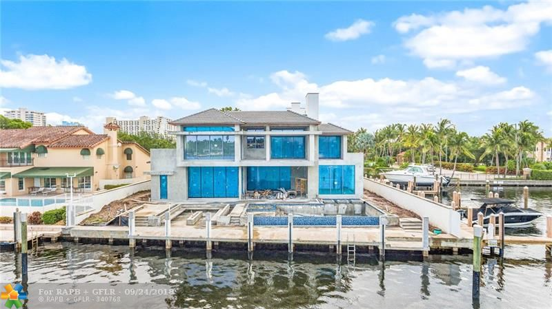 Latest new construction offering in Harbor Beach! Beautifully refined Coastal Modern design by Randy Stofft/Builder Sarkela Corp.Incredible Lake Sylvan (open to intracoastal) & Marina views from large corner property exciting custom pool.Very open feeling, multiple expansive loggias/balconies inc roof terrace & metal roof. Abundant windows blend indoor/outdoor entertaining areas with imaginative floorplan to capture stunning views from many angles &  island ambiance. Enjoy the private Surf Club across A1A