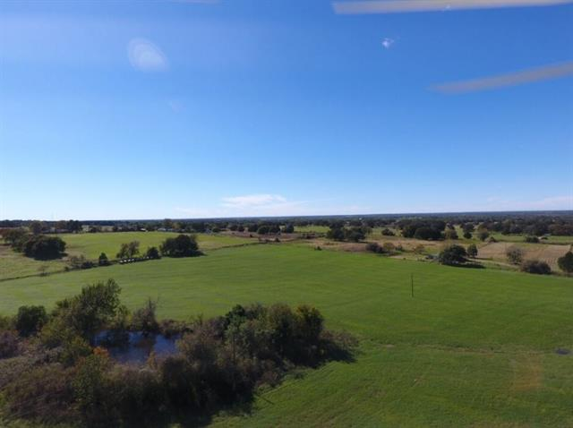 Great place for farm and ranch, recreational, or to build a home.  33.74 nicely maintained, usable acres of improved coastal, with scattered trees and a pond. Each tract can be purchased separately (15 acres & 18.74 acres) or as a whole. Excellent location with ag exemption in place.