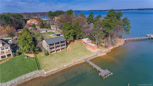 "Extraordinary Opportunity to own and build on Lake Norman. This gorgeous and unique property features 160 +/- ft of shoreline, a concrete sea wall, 2 ""grandfathered"" boat houses and a gently sloping .66 acre lot with unobstructed big water views. Incredible sunrises are captured on this eastward facing lot with no HOA restrictions. This incredibly rare lot is the perfect setting for your next dream home. Bring your builder!!"