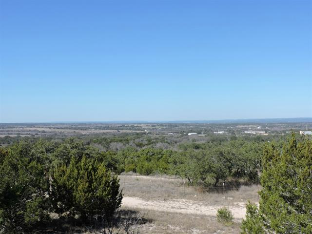 Beautiful treed 10.54 acre tract with hill top, numerous building sites and expansive long distant views. Paved road frontage, horses allowed, 900 sqft minimum site built home required....choose your own builder. Approx. 20 minutes from Lakeway. Bee Cave Galleria and Marble Falls. Great location with Lake Travis and Lake LBJ just minutes away. Not many tracts of land like this left in the Austin Hill Country.