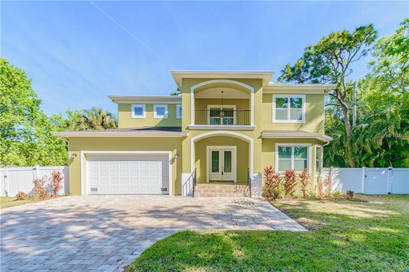 Brand-new construction (never lived-in) - a residence in the desirable Beach Park/Swann Estates area of Westshore in Tampa!  This two-story residence, due to ownership change, is now available.  The livability factor is high with this residence - its large backyard (corner lot), open floor plan, 4 bedrooms plus bonus room, 3 and 1/2 baths and all with a lot of natural light.  Shade trees provide desirable mature landscaping.   Custom flooring, stainless steel appliances, granite counter tops, everything is new....  Laundry room on first floor. Plenty of storage space. Fenced in back yard.  Backyard wraps around a shaded porch with ceiling fans. Two car garage as well as out front parking. Ready to move-in, ready to show anytime!