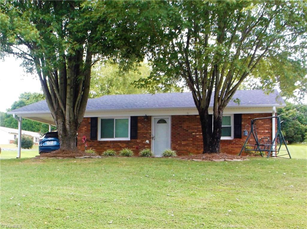 Darling updated brick ranch in great location!! 3BR/1.5BA, large kitchen/dining area has gorgeous cabinets, tile backsplash, large pantry, built-in microwave, dishwasher, ss refrig will also stay, nice size living room, recent updates also include paint, flooring and roof, both baths have also been updated, stackable washer and dryer will stay, sits on large corner lot, pretty landscaping, paved driveway, attached carport, storage building, great starter home, A Must See!!!!