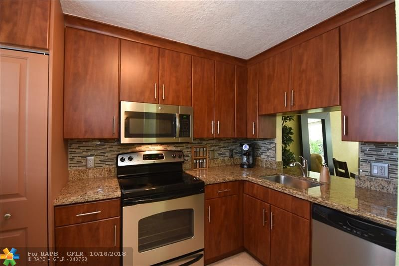 This home could be featured in House Beautiful. Finally a 2 bedroom condo that has it all. Impact windows and impact sliding door, new kitchen and new air conditioner. Light, bright and airy best describes this sun drenched unit on the 3rd floor. Kitchen boasts granite countertops and stainless steel appliances. Both bathrooms remodeled. Magnificent travertine floors tile throughout. Plantation shutters. Dogs up to 30lbs allowed. Renting allowed after 3rd year of ownership.