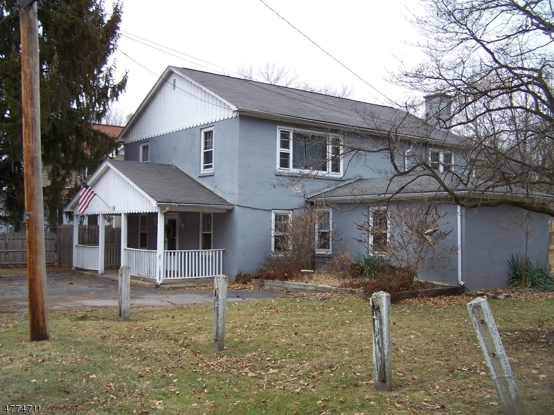 Half House 1st floor unit with large rooms. Covered front porch. Patio &  3 season porch flows into the back yard.. Laundry /Utility room, Very convenient to Rt-80,46 & 94 and the Poconos.