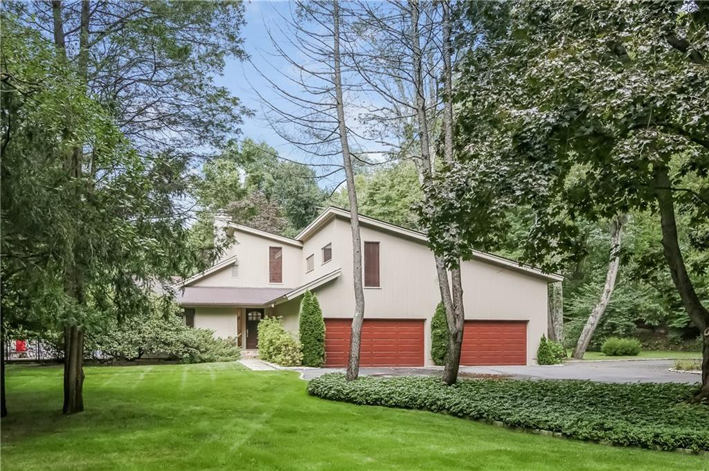LOOKING FOR THE PERFECT RETREAT, THIS 4 BEDROOM, 4 BATH HOME OVERLOOKS A QUIET LAKE ON 2.3 ACRES. TOTALLY RENOVATED IN 2008, HARDWOOD FLOORS THROUGHOUT. THE LIVING ROOM, DINING ROOM, KITCHEN & FAMILY ROOM LOOK OUT ONTO THE POOL AND LAKE. ALL DOORS LEADING OUT TO THE IN- GROUND HEATED POOL.