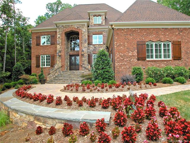 IMMACULATE and QUALITY are the first two words that come to mind as soon as you open the front door to this European-Inspired Custom Home. Each room offers something special, custom ceilings, extensive moldings, designer light fixtures, hardwoods throughout main level, two staircases. A true chef's kitchen with large island, premium cabinets, walk-in pantry, separate breakfast and bar area. Spacious bedroom suites, bonus room and theater room. Sealed Crawlspace, Covered Patio with Brick Pavers.