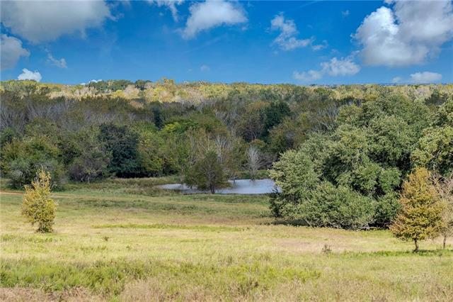 +/- 235 Acre Ranch in Lee County between Dime Box and Ledbetter. Very unique property on the north side of FM 1697 and paved frontage on CR 124 . This Ranch is being used for cow-calf operation with excellent hunting potential or fishing in the 9 ponds. Lee County Water Supply and Bluebonnet Electric. Stunning views with multiple hilltops & over 100' of various elevation changes. Rolling topography, gorgeous oak trees, sandy loam soil, & overall gorgeous Ranch that will suit any recreational need.